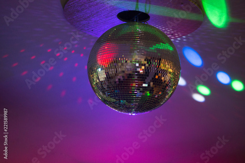 Silver disco ball in purple light - 221589987