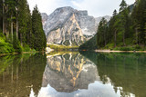 Lake braies also known as Lago di Braies. The most beautiful lake in Dolomites and Alps. A huge mountain reflecting in the water before sunset. National park Fanes Sennes Braies, South Tyrol, Italy.  - 221594199