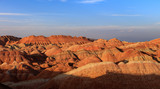 Zhangye Danxia National Geopark - Gansu Province, China. Chinese Danxia multicolor danxia landform, rainbow hills, unusual colored rocks, sandstone erosion, layers of Red, Yellow and Orange stripes - 221604586