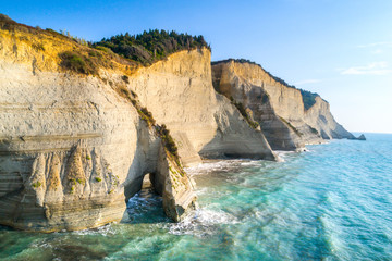 Logas Beach and amazing rocky cliff in Peroulades. Corfu Island. Greece