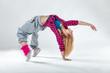 Leinwanddruck Bild - Young beautiful slim girl dancing on a white studio background