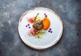 Duck leg confit with batat puree, carrots and couscous, restaurant meal - 221620375