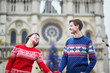 Couple on a street of Paris decorated for Christmas