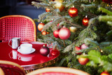 Outdoor Parisian cafe with beautiful Christmas tree - 221621334