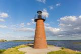 lighthouse on coast of sea - 221623151