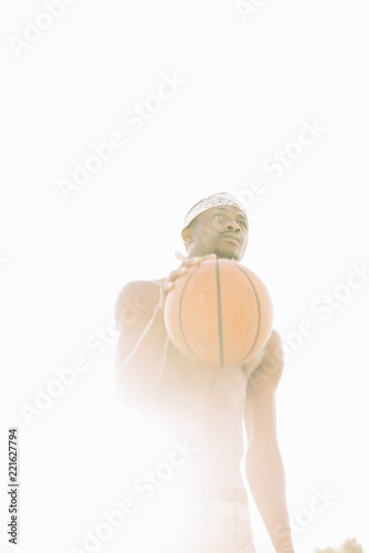 Afro Man Basketball Player In A Street Court