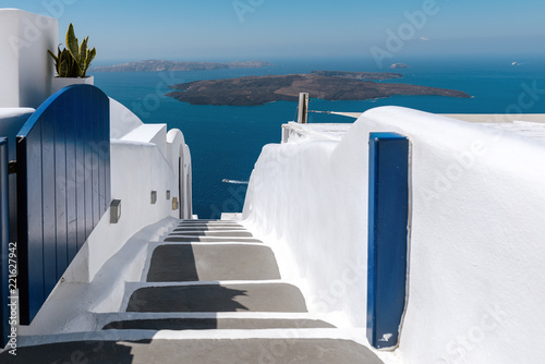Foto Murales Open gate with road down to the sea at Santorini island, Greece