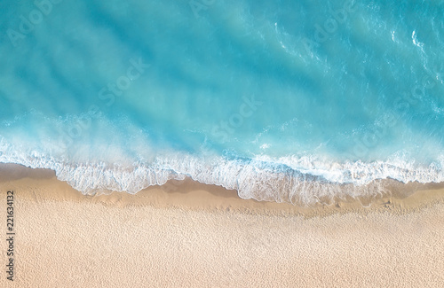 Foto Murales Beach and waves from top view. Aerial view of luxury resting at sunny day. Summer seascape from air. Top view from drone. Travel concept and idea