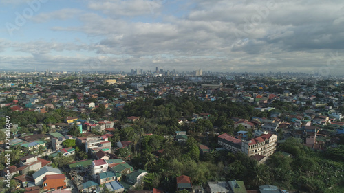 Foto Murales Aerial view of Manila city with skyscrapers and buildings. Philippines, Luzon. Aerial skyline of Manila.