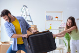 Young family with suitcase in relocation concept - 221647354