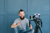 blogger streaming live. bearded hipster man communicating with subscribers through camera. new modern occupations and ways of earning money online concept. - 221647566