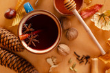Mulled wine or gluhwein  with cinnamon stick,anice stars and honey. Seasonal and holidays concept. Selective focus - 221657716