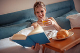 Breakfast in bed for young beautiful woman - 221658546