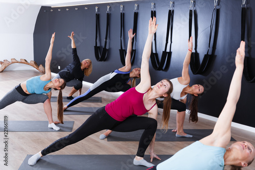 Girls practicing yoga positions indoors