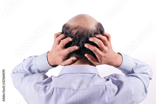 bald businessman with his head on scalp view from behind with white background © Jadoo