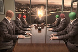Men with match heads on shoulders hold a production meeting - 221666385