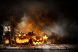 Halloween pumpkins on wooden planks. - 221666982