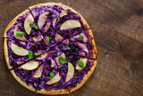 sweet pizza with ricotta cheese, blueberry and slices apple. dessert pizza on a wooden background - 221667594