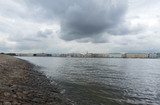 embankment of the Neva River in St. Petersburg, buildings along the Neva River, the sky with gray clouds over the city, Russia - 221672736