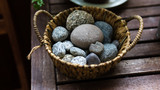 Stones on a basket. - 221679123