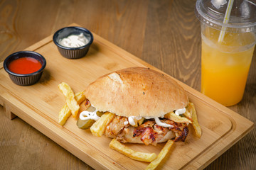 Delicious doner kebab on wooden background