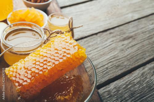 Poster Different varieties of sweet golden fresh honey