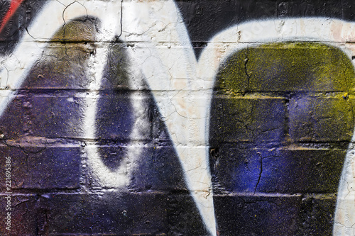 Graffiti painted on a brick wall texture. - 221695386