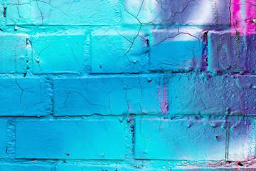 Graffiti painted on a brick wall texture.