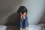 Kidnapped little girl tied with rope.Abused and tortured concept. Human trafficking concept. Stop violence against Women. International women's Day. Stop abusing violence. - 221698947