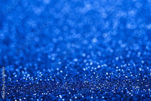 Błyszczący błękitny abstrakcjonistyczny bożego narodzenia tło. Niebieski blask.