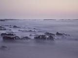 Wet sea rocks at dusk - 221704939