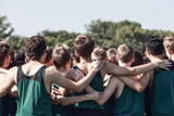Boys on cross country team in a huddle - 221705306
