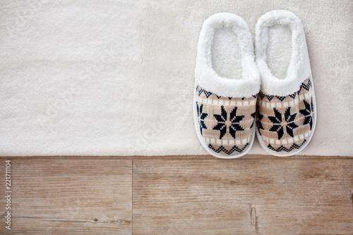Leinwanddruck Bild Slippers on wooden floor