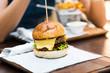 Cheeseburger o a tray in the restaurant - 221714342