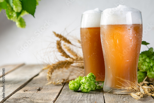Beer and ingredients hops, wheat, barley on wood background, copy space - 221720365