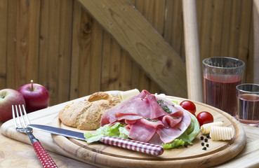 bread with ham on wooden plate