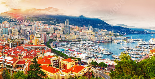 Leinwanddruck Bild Principality of Monaco. Picturesque panoramic view on Monaco on sunset hour. View on apartment building, casino, port with luxury yachts. Monaco is popular travel destination for gambling.