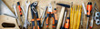 Leinwandbild Motiv Panorama banner of assorted hand tools on wood