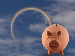 Terracotta pig money box with cloudy sky and rainbow. Money management, investment concept. Aka piggy bank.