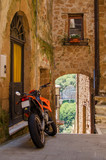 Motorbike on the old street of Pitigliano, Italy