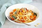 Pumpkin pasta. Spaghetti with roasted pumpkin, crispy bacon strips and sage liaves.