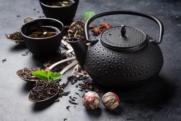 Various tea in spoons and teapot © karandaev