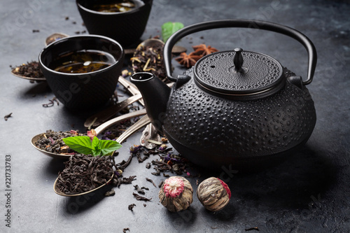 Various tea in spoons and teapot