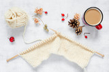 Knitting of yarn, red mug with hot drink  - 221736751
