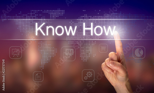 A hand selecting a Know How business concept on a clear screen with a colorful blurred background.