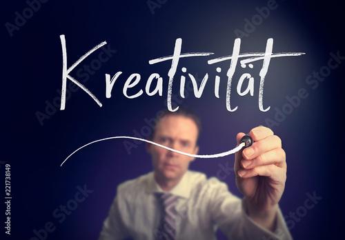 Fototapeta A businessman writing a Creativity