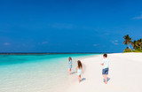 Mother and kids at tropical beach - 221739703