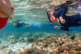Family mother and kids snorkeling - 221740509