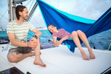 Family on board of sailing yacht - 221740925