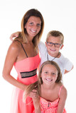 Happy young family with two children smiling posing at camera isolated on white - 221742149
